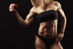 Studio shot of muscular young woman Royalty Free Stock Photos