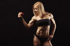 Studio shot of muscular young woman Royalty Free Stock Image