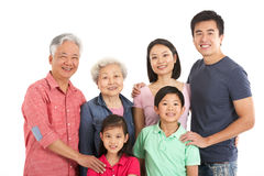 Studio Shot Of Multi-Generation Chinese Family Stock Photo