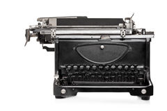 Studio shot of an old style typing machine. Against white background Royalty Free Stock Photo