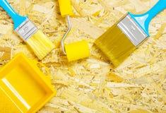 Paint tools on plywood. Studio shot paint tools on plywood stock photos