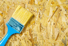 A paintbrush on plywood Stock Images