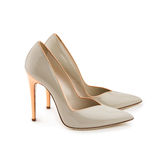 Studio shot of a pair of a grey high-heeled female shoes royalty free stock photos