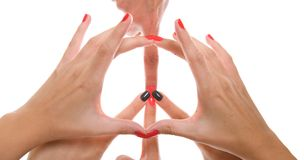 Studio shot of a peace sign formed by using hands Royalty Free Stock Images