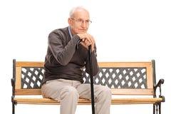Studio shot of a pensive senior gentleman Stock Images