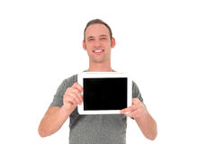 Smiling young man showing his tablet Royalty Free Stock Photography