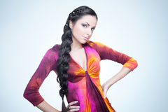Studio shot of a pretty lady with a thick braid Stock Photos