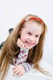 Studio shot of pretty little girl. Studio shot of laughing pretty little girl with wide smile Royalty Free Stock Images