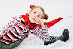 Studio shot of pretty little girl. With a red handkerchief around her neck Stock Photos