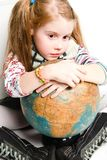 Studio shot of pretty little girl. With the globe Royalty Free Stock Images
