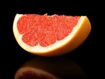 Studio shot quarter grapefruit isolated black Royalty Free Stock Photography