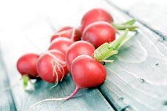 Studio shot of radish on wooden table Stock Photo