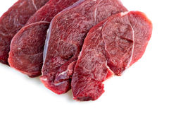 Studio shot of raw red meat steaks isolated against a white back Royalty Free Stock Photography