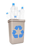 Studio shot of a recycle bin full of plastic bottles Royalty Free Stock Photos