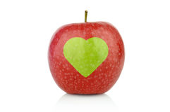 Studio shot of red apple with health heart sign Royalty Free Stock Photos