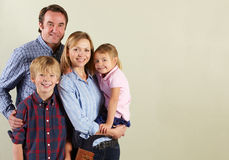 Studio Shot Of Relaxed Family Stock Photography
