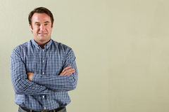 Studio Shot Of Relaxed Middle Aged Man Stock Images