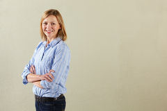 Studio Shot Of Relaxed Middle Aged Woman Stock Image