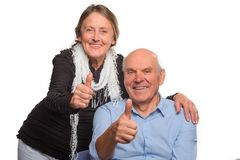 Granny and grandpa show OK stock photography