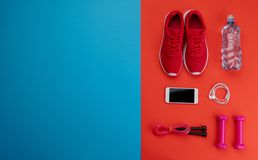 A studio shot of running shoes and other sport equipment on color background. royalty free stock photography