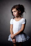 Studio shot of sad little artistic gymnast Stock Images