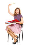 A studio shot of a schoolgirl raising her hand Stock Images