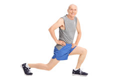 Studio shot of a senior doing a stretch exercise Royalty Free Stock Photos