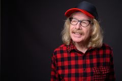 Senior man with mustache against gray background stock photography