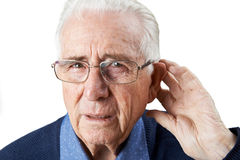 Studio Shot Of Senior Man Suffering From Deafness. Senior Man Suffering From Deafness Stock Photography