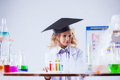 Studio shot of serious girl posing in chemical lab Stock Photos
