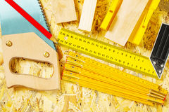 Set of construction tools on plywood Stock Images
