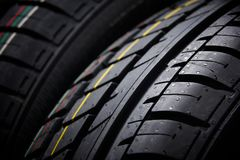 Studio shot of a set of summer car tires on black background. Contrasty lighting Stock Photos