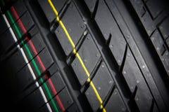 Studio shot of a set of summer car tires on black background. Contrasty lighting. Studio shot of a set of summer car tires on black background close up Royalty Free Stock Photo