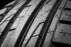 Car tire isolated on black background. Tire stack. Car tyre protector close up. Black rubber tire. Brand new car tires. Close up b stock images