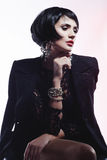 Fashion Woman in Black Guipure Dress. Professional Makeup Stock Photo