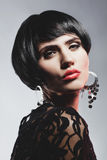 Fashion Woman in Black Guipure Dress. Professional Makeup Royalty Free Stock Image