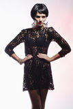 Sexy Fashion Woman in Black Guipure Dress. Professional Makeup Stock Image