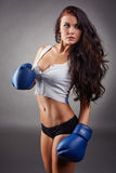 Studio shot of girl in boxing gloves Royalty Free Stock Images