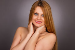 Studio shot of sexy young woman with long blonde hair Royalty Free Stock Images