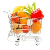 Shopping Cart With Vegetables And Fruit, Side View. Studio shot of a shopping cart with vegetables and fruit, side view Royalty Free Stock Image