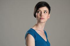 Studio shot of short hair beauty model looking back over the shoulder with copyspace Stock Photography