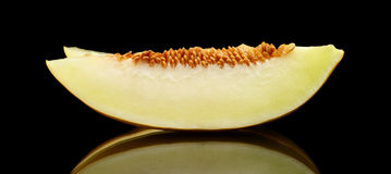 Studio shot slice Canary melon isolated black Royalty Free Stock Photography