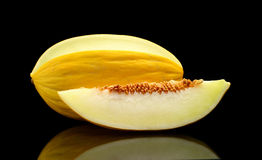 Studio shot of sliced Canary melon isolated black Royalty Free Stock Image
