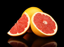 Studio shot sliced three grapefruits isolated black Royalty Free Stock Photography