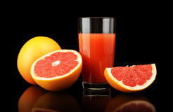 Studio shot sliced three grapefruits with juice isolated black Royalty Free Stock Photos