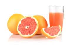 Studio shot sliced three grapefruits with juice isolated white. Studio shot of sliced three grapefruits with grapefruit juice isolated white background Stock Image