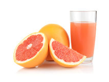 Studio shot sliced three grapefruits with juice isolated white Royalty Free Stock Photos