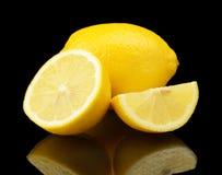 Studio shot sliced three lemons isolated on black Royalty Free Stock Images