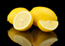 Studio shot sliced three lemons isolated on black Stock Images