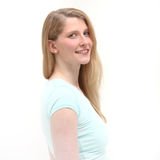 Studio shot of smiling blonde woman Stock Image